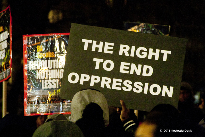 Protestors hold up signs during the Trayvon Martin Vigil at Union Square on Tuesday, February 26, 2013.