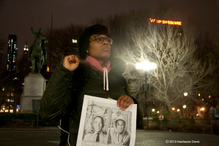 Sydney Chatman holds up a fist for Trayvon Martin at the vigil in Union Square on Tuesday, February 26, 2013.