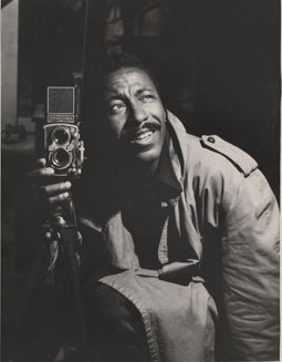 Gordon Parks with camera.