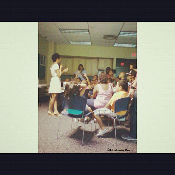 Nastassia Davis speaking to students during Photography Workshop in Pleasantville, NJ.